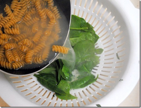 pouring water over spinach