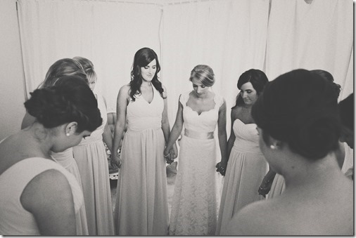 Bridesmaids Praying together before ceremony