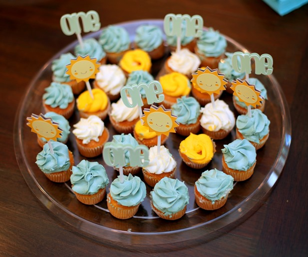 Whole Foods Cupcakes with Sunshine Cupcake Toppers for You Are My Sunshine Birthday Party